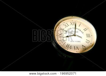 Image of a clock showcasing mock grand central station and railway station time.