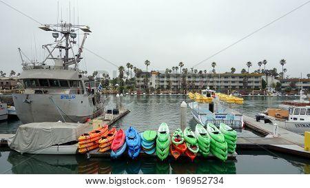 OXNARD CA USA - JULY 4 2013: Recreational and fishing boats at the dock in Oxnard marina Ventura county Southern California Pacific coast; copy space