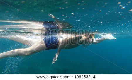 swimmer swims into the sea