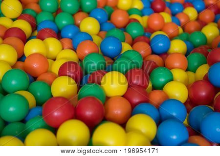 Colorful plastic toy balls in the play pool of a playground