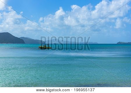 Boat In Beautiful Lagoon Surrounded By Mountains