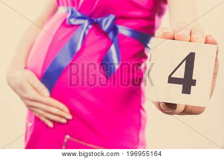 Vintage Photo, Hand Of Woman In Pregnant Showing Number Of Fourth Month Of Pregnancy, Expecting For