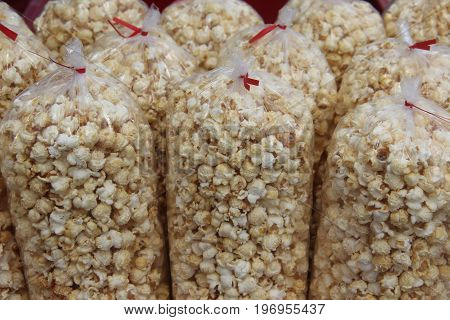 Bags of sealed popped popcorn at a carnival