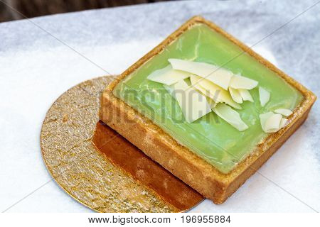 Green Keylime Tart Pastry With A Cookie Crust And White Chocolate Flakes