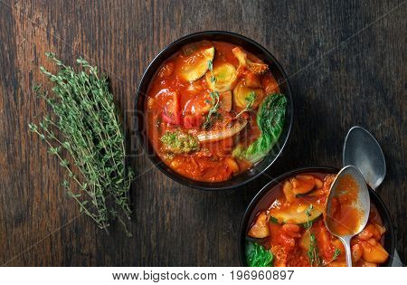 Italian food. Two bowl of soup minestrone with seasonal vegetables on wooden table top view