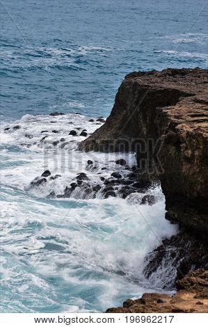 down shot of cliff at Kaena Point Hawaii