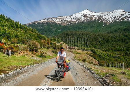 Cyclist on a cycle touring trip on the stunningly beautiful Carretera Austral route, southern Patagonia, Chile, South America