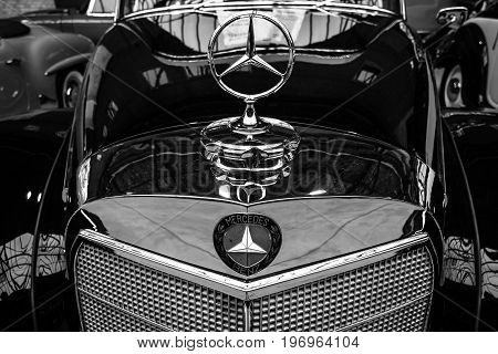 BERLIN - MAY 10 2015: Fragment of a limousine Mercedes-Benz 300 S Cabriolet (W 188 I) 1953. Black and white. Produced 203 cars. 28th Berlin-Brandenburg Oldtimer Day