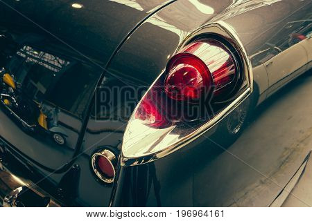 BERLIN - MAY 10 2015: The rear brake lights vintage car Facel Vega FV4 Typhoon 1958. Stylization. Toning. 28th Berlin-Brandenburg Oldtimer Day