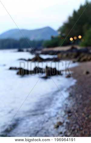 Blurred scene of evening beach for ues as background.