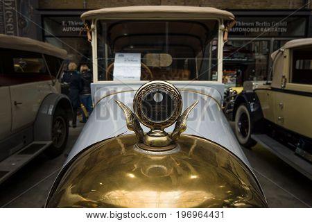 BERLIN - MAY 10 2015: Hood ornament of vintage car of the German manufacturer NAG C4 10/30 Phaeton. 28th Berlin-Brandenburg Oldtimer Day