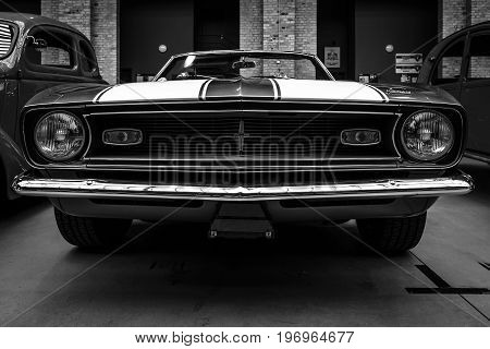 BERLIN - MAY 10 2015: Pony car Chevrolet Camaro SS (first generation) convertible 1968. Black and white. 28th Berlin-Brandenburg Oldtimer Day