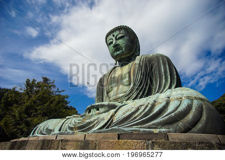 The Great Buddha Statue (Daibutsu) in Kamakura Japan with copy space.