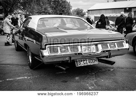 BERLIN - MAY 10 2015: Full-size car Chevrolet Caprice 1973. Black and white. Rear view. 28th Berlin-Brandenburg Oldtimer Day