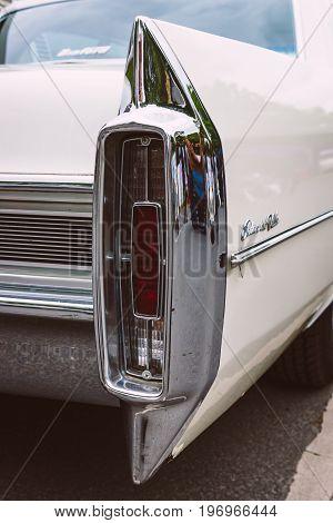 BERLIN - MAY 10 2015: The rear brake lights full-size luxury car Cadillac Sedan De Ville. Stylization. Vintage toning. 28th Berlin-Brandenburg Oldtimer Day