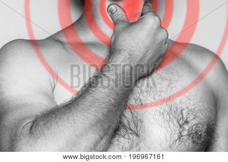 Man holding his hand on his throat acute pain. Monochrome image isolated on a white background. Pain area of red color.