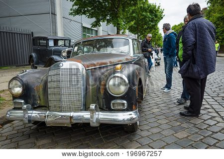 BERLIN - MAY 10 2015: A rusty and battered body of a luxury car Mercedes-Benz 300d (W189). 28th Berlin-Brandenburg Oldtimer Day