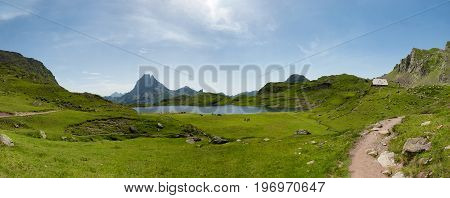 View of the mountain Pic du Midi d'Ossau in the French Pyrenees with lake