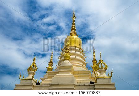Golden pagoda with blue sky background of Rong Sua Ten temple is poppula tourist attraction of  Chiang Rai Province, Thailand.