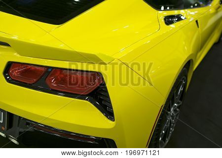 Sankt-Petersburg Russia July 21 2017: Back view of a yellow sport car Chevrolet Corvette Z06. Car exterior details. Photo Taken on Royal Auto Show July 21