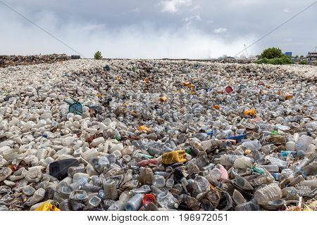 plastic waste dumping landfill site and open burning area