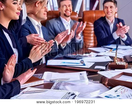 Business people office life of team people working with papers sitting table. Cabinets with folders and jalousie background. People like a beautiful presentation.