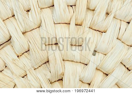 weaved round straw detail on a basket
