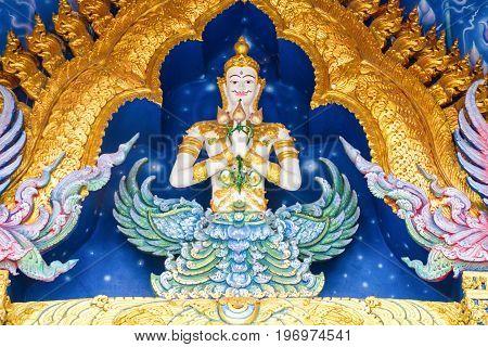 Chiang Rai Thailand - July 12 2017: Deva Statue Image Inside Wat Rong Sua Ten Or Blue Temple.