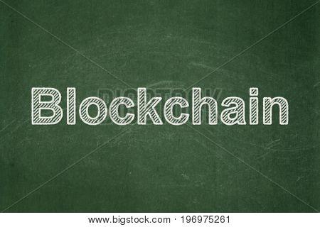 Money concept: text Blockchain on Green chalkboard background