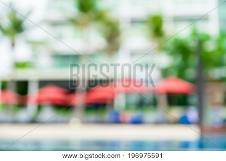 Blurred Background,beach Umbrella And Palm Tree At Swiming Pool At Resort