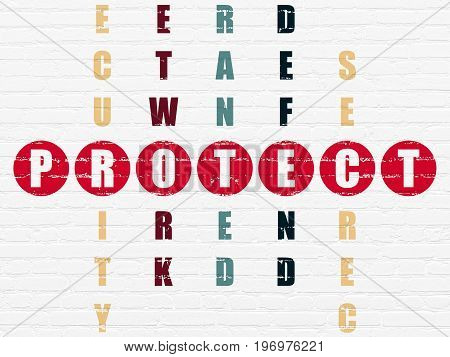 Security concept: Painted red word Protect in solving Crossword Puzzle