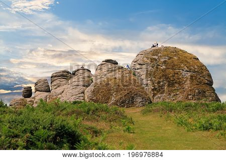 Haytor Rocks in the middle of Dartmoor National Park is a popular place for hiking and walking.  Devon, England