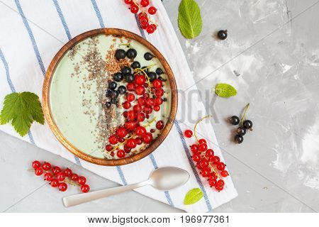 Spirulina smoothie bowl with berries and chia. Love for a healthy vegan food concept.