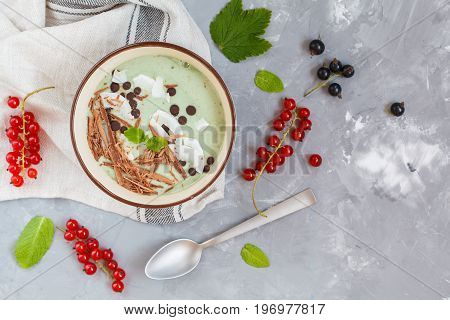Spirulina smoothie bowl with chocolate and coconut. Love for a healthy vegan food concept.