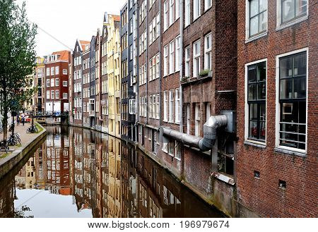 Amsterdam Holland Europe - reflection of the buildings facade in the canal