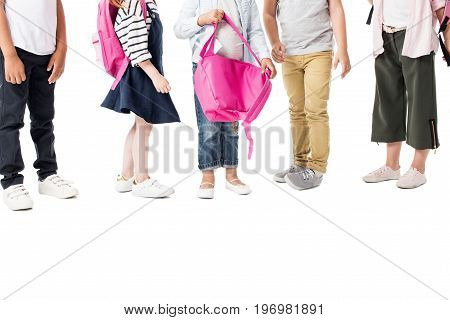 Cropped Shot Of Multiethnic Children With Backpacks Standing Together Isolated On White