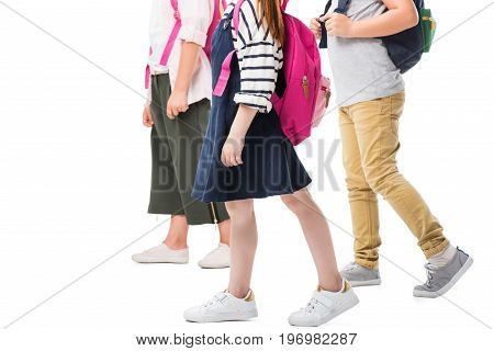 Cropped Shot Of Children With Backpacks Walking Together Isolated On White