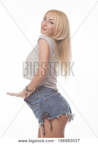 Sexy flat belly of a woman in low-cut skinny blue jeans