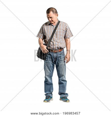 Portrait Of A Happy Mature Man Standing In Scott Shirt And Blue Jeans Looking To The Bottom Left Sid