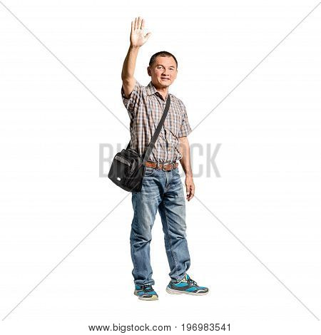 Portrait Of A Happy Mature Man Standing In Scott Shirt And Blue Jeans Showing His Hands. Isolated Fu