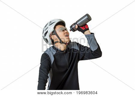 Portrait of a young asian man cyclist with helmet and sportswear drinking water on his bicycle. Isolated on white background with clipping path