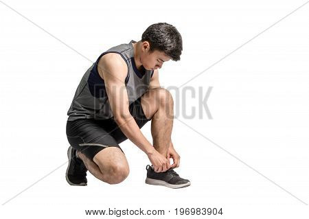 Portrait Of An Asian Sport Man Tying His Shoes For Running. Isolated Full Length On White Background