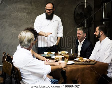 Chef explaining a dish to a customer