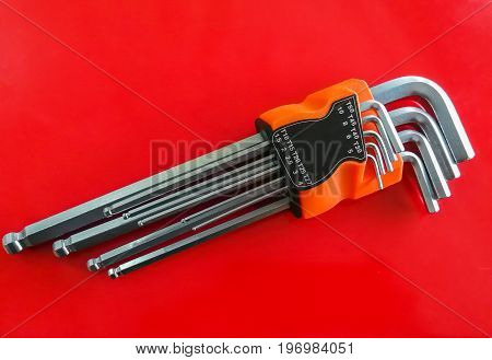 Hex key Set on white background.A hex key Allen key or Allen wrench is a tool used to drive bolts and screws with hexagonal sockets in their heads