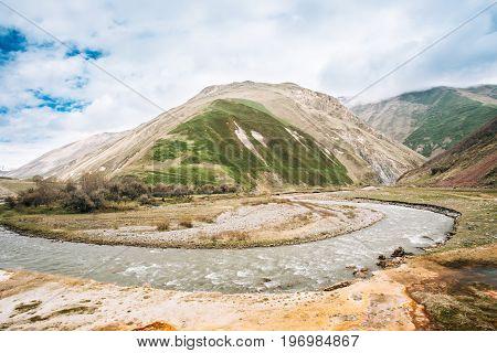 Terek River Flows Through Georgia And Russia Into Caspian Sea. Spring Landscape With River Terek Near Ketrisi Village In Kazbegi District, Mtskheta-Mtianeti Region, Georgia