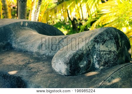 Honolulu Hawaii - May 27 2016: Close up of a Moai face on display at the Polynesian Cultural Center. Moai are monolithic human figures carved by the Rapa Nui people on Easter Island in eastern Polynesia between 1250 and 1500 A.D.