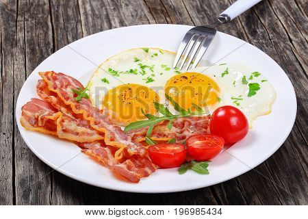 Crispy Fried Bacon And Eggs On Plate