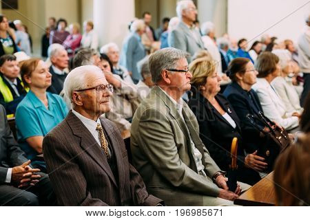 Vilnius, Lithuania - July 6, 2016: People Parishioners in Cathedral Basilica of Saints Stanislaus and Vladislaus during celebration of Statehood Day. Holiday in commemorate coronation in 1253 of Mindaugas King.