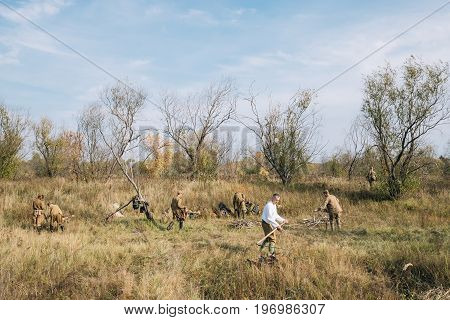 Dyatlovichi, Belarus - October 1, 2016: Group Of Reenactors Dressed As Russian Soviet Red Army Infantry Soldiers Of World War II Equips Camp At Historical Reenactment