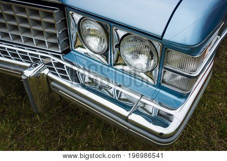 PAAREN IM GLIEN GERMANY - MAY 23 2015: Fragment of a full-size luxury car Cadillac de Ville series 1974. The oldtimer show in MAFZ.
